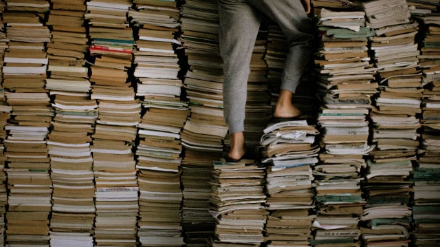 person standing on books